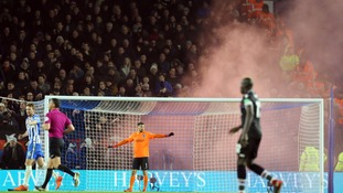 Crystal Palace fans let off smoke bombs in the stands during the Premier League match at the AMEX Stadium, Brighton
