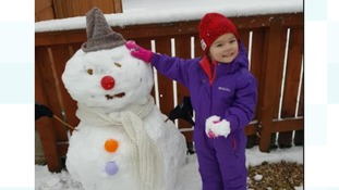 """My daughter Ella building her first proper snowman in Langholm"""