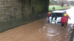 A driver had to be rescued from flood water outside Dorchester