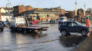 The River Nith flooding into Whitesands car park