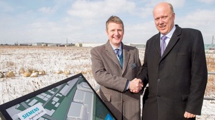 Gordon Wakeford, Siemens' Managing Director, UK Mobility Division, welcomes Transport secretary Chris Grayling to the Goole site
