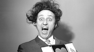Sir Ken Dodd, who has died aged 90, with his award for Show Business Personality of the Year.