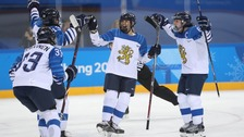 Finland players celebrate a goal against Sweden in the women's ice hockey quarterfinals during the Pyeongchang 2018 Olympic Winter Games