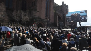 Crowds gathered outside the cathedral to watch the funeral on a big screen.