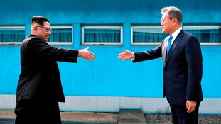 Kim stepped over the world's most heavily armed border to greet his rival
