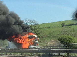 The fire broke out on the M62 westbound between J22 and J21