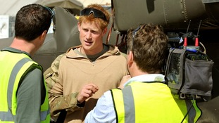 Prince Harry in November 2012 giving a TV interview by his helicopter in Camp Bastion