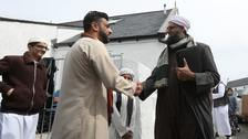The Muslim community greet Iman Mufti Abdur Rahman Mangera at the official opening of the mosque.