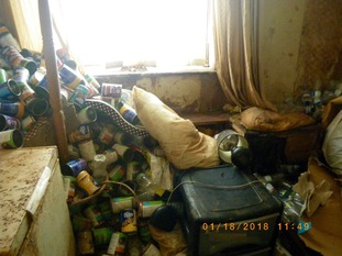 Approximately 300 empty cat food cans were found strewn in one of the rooms where the animals were kept