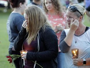 Santa Fe High School freshman Kylie Trochesset, left, and her mother, Ashlee, wipe away tears during a prayer vigil