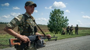 Russian-backed rebels guarding the site of the crash in 2015.