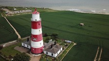 The 85-ft Happisburgh lighthouse has stood on the Norfolk coast since 1791.