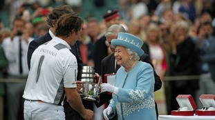 Queen presenting the trophy