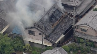 Smoke rises from a house blaze in Takatsuki, Osaka.