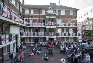 England fans come together at the Kirby Estate in Bermondsey.