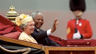 Nelson Mandela and The Queen ride in a Mall, London Mall, London, on his state visit to Britain in 1996.