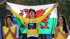 Geraint Thomas holding welsh flag