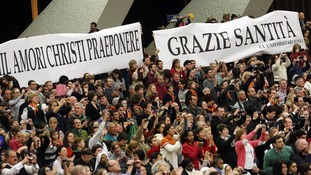 A sign in Italian saying 'Thanks Holiness' is seen as Pope Benedict XVI begins his general audience