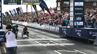 David Weir crosses the line in record time.