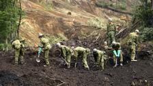 Japan's Self-Defence Force members work at the site of a landslide triggered by the earthquake in Atsuma, Hokkaido, northern Japan.