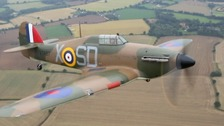 A Battle of Britain Hurricane is flying again after nearly 80 years after being restored and rebuilt in Suffolk.