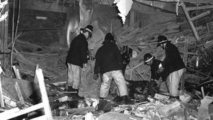 Firemen at work following the bomb attacks in Birmingham city centre.