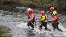 Officers in the River Irwel