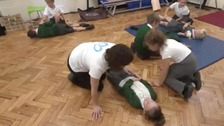 Schoolchildren learn vital skills to save lives