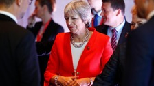 May fights to bridge gap to Brexit deal as she heads to Brussels