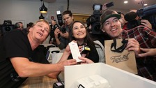 Canopy Growth CEO Bruce Linton, left to right, poses with the receipt for the first legal cannabis for recreation use sold in Canada
