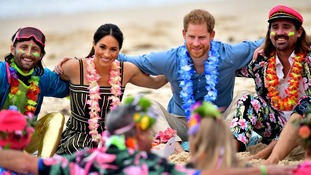 Harry and Meghan take part in a mental health discussion on Bondi Beach.