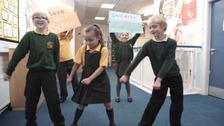 Schoolchildren protesting by doing the floss dance.