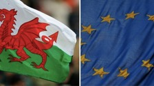 Welsh flag and EU flag