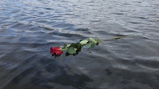 The rose the woman left made its way into the lake.