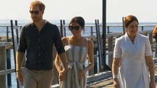 Meghan rejoins Harry for sun-kissed stroll on Fraser Island