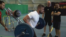 Record-breaking weightlifter inspires others with cystic fibrosis