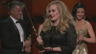 Adele and her songwriting partner Paul Epworth pick up an Oscar for Skyfall