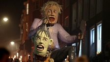 An effigy of Boris Johnson is paraded through the town of Lewes in East Sussex during an annual Bonfire Night procession.