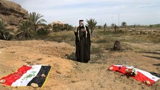 The site of a mass grave, believed to contain the bodies of Iraqi soldiers killed by Islamic State group militants when they overran Camp Speicher military base, in Tikrit, Iraq.
