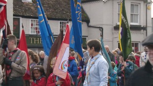 Guides and scouts join a remembrance parade in Godmanchester