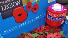 Thieves target poppy appeal collection tins.