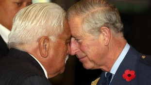 Charles is greeted with a hongi by Grant Hawke during a welcome ceremony at Auckland War Memorial Museum.