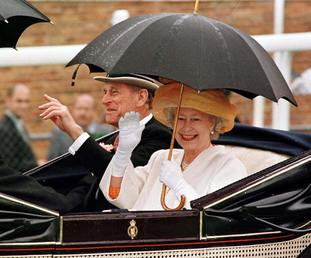 The Queen and Duke of Edinburgh arrive on the course at a rain-swept Royal Ascot in 1997
