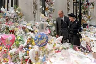 The Queen and the Duke of Edinburgh view the floral tributes to Diana, Princess of Wales, at Buckingham Palace in 1997