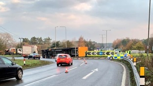 Police respond to reports of an overturned lorry on the A11
