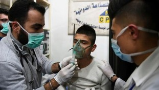 A child receiving oxygen through respirators following a suspected chemical attack on his town of al-Khalidiya