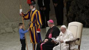 Boy 'expresses himself' by climbing on stage in front of the pope at the Vatican