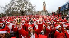 Participants in Santa costumes meet in Brixton, south London, before making their way through the streets of London.