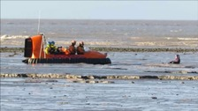 The boy sat in the mud for 40 minutes while a specialist hovercraft was sent to rescue him