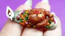 Miniature Christmas meal on a nail